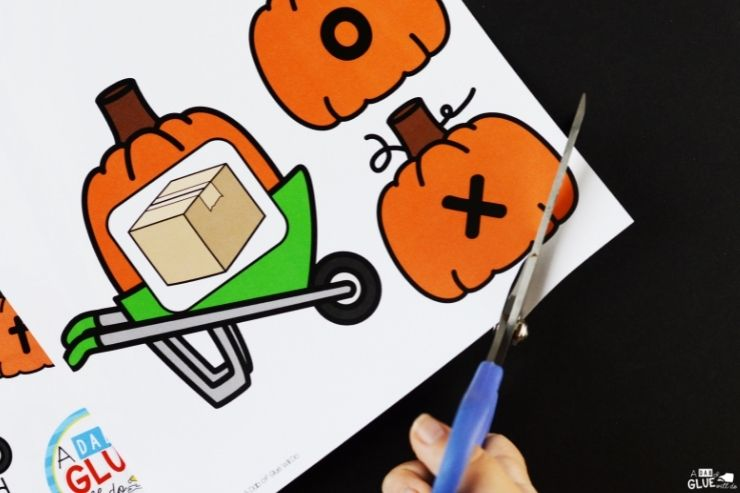 Cutting out the pumpkins for CVC word box. Pumpkin CVC Word Building Activity is perfect for teaching word building. Use this fall theme game to build students phonetic awareness.